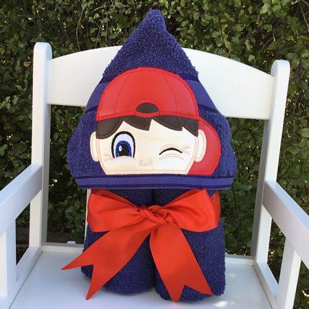 Winking boy hooded towel