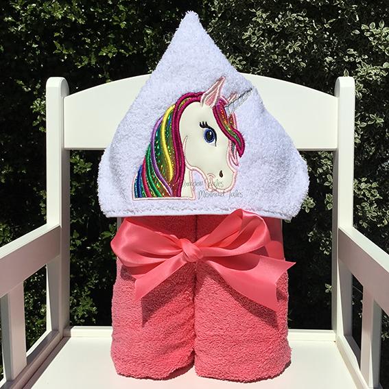 Bright rainbow unicorn hooded towel